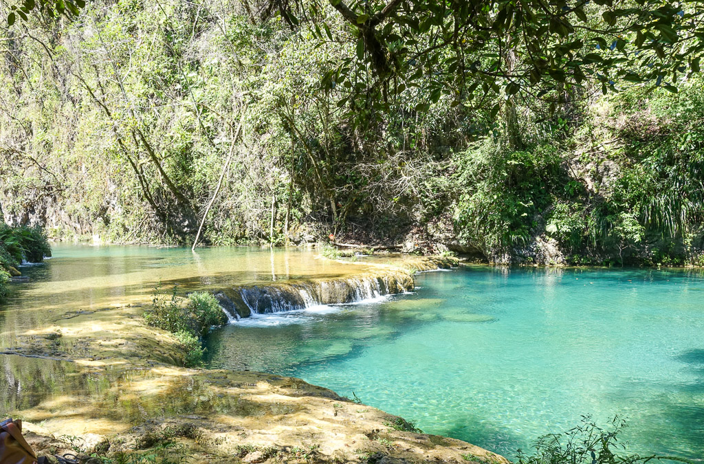 In this article you'll learn about things to do in Semuc Champey, the beautiul National Park in the Guatemalian Jungle. How to get there and how to prepare for your visit. Backpacking in Guatemala.    #travel #backpacking #guatemala #semucchampey #centralamerica #guide #adventure #lowbudget